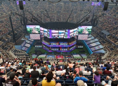 Spectators follow the Fortnite World Cup at the Arthur Ashe Tennis Stadium in New York on Saturday.