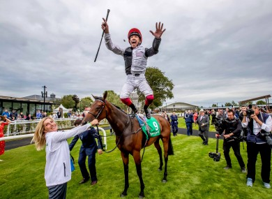 Frankie Dettori celebrates winning The Kerrygold Irish Oaks on Star Catcher.