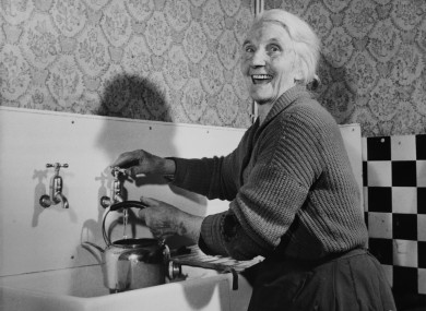 Mrs Ellen Scannell gets running water into her kitchen in Lissivigeen, County Kerry, April 1962.