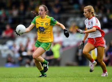 Megan Ryan of Donegal tries to get away from Tyrone's Emma Brennan at TEG Cusack Park in Mullingar, Co Westmeath.