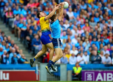 Michael Fitzsimons and Diarmuid Murtagh challenge for a high ball.