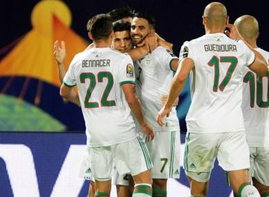 Riyad Mahrez (C) leads Algeria celebrations against Guinea.