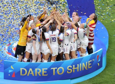 US players celebrate with the trophy.