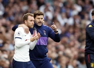 Mauricio Pochettino, centre, gives instructions to Tottenham's Christian Eriksen during last week's match against Aston Villa.