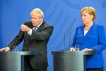 Boris Johnson and Angela Merkel answer questions at a press conference.