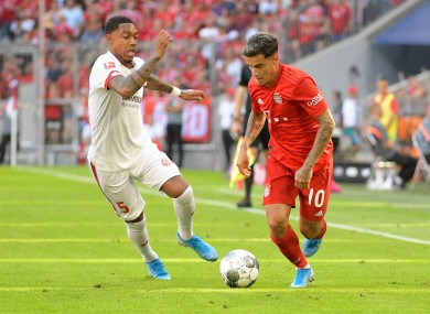 Jean-Paul Boetius and Philippe Coutinho compete for possession.