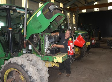 Paddy Phelan - a fitter with Bord na Móna - works on a tractor in the workshop in Ferbane, Co Offaly.