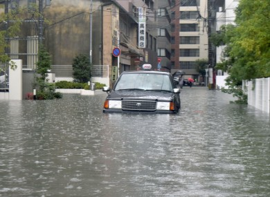 A car submerged in floodwaters in Japan