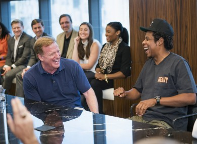 NFL Commissioner Roger Goodell, left, and Jay-Z appear at a news conference.