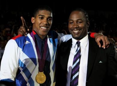 Anthony Joshua (L) and Lennox Lewis.