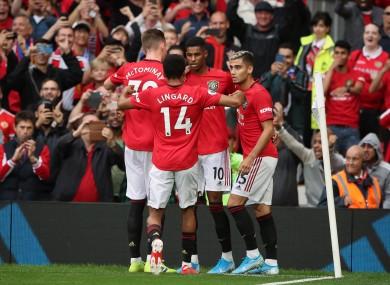 Marcus Rashford celebrates a goal with team-mates.