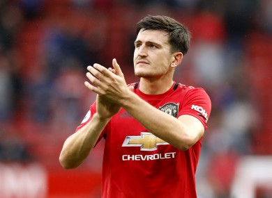 Manchester United's Harry Maguire applauds the fans.