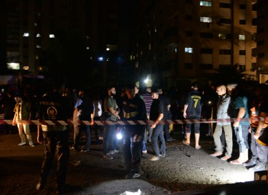 Palestinians gather at the site of an explosion in Gaza City last night