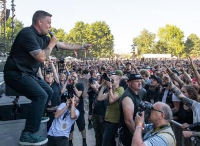 Ken Casey of the Dropkick Murphys leading the crowd at 'Rock im Park' festival in Nuremberg, Bavaria, back in June.