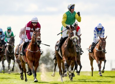 Tudor City and Robbie Power won the Galway Hurdle on Thursday - but a delayed maiden hurdle at Goodwood clashed with Europe's richest hurdle race.
