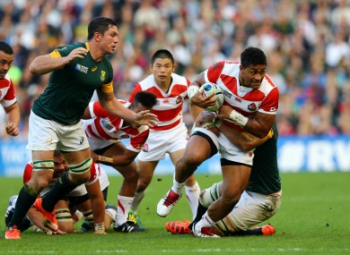 Mafi makes a carry as Japan defeated South Africa.