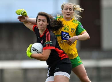 Shannon Lynch of Tyrone in action against Niamh McLaughlin of Donegal.