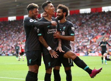 Roberto Firmino celebrates doubling Liverpool's lead.