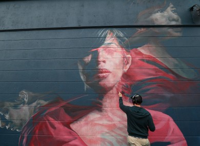 Artist Spear works as part of the Waterford Walls graffiti and street art festival.