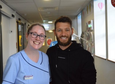 Wes Hoolahan and a staff member from Temple Street Children's University Hospital.