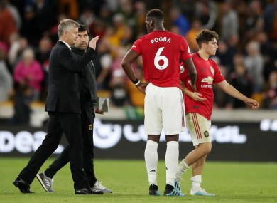 Ole Gunnar Solskjaer greets Paul Pogba after the game.