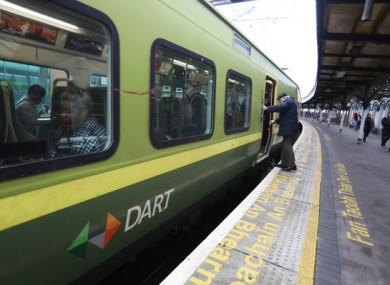A passenger boarding the DART.