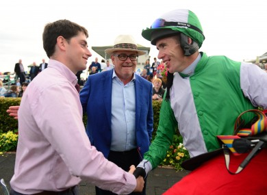 Jockey Derek O'Connor with trainer Emmet Mullins (left) and owner Michael Mee after winning the Monami Construction Flat Race onboard Russian Diamond during day one of the 2019 Summer Festival at Galway Racecourse.