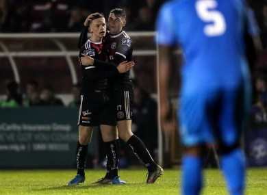 Andy Lyons celebrates scoring a goal with Ryan Graydon.