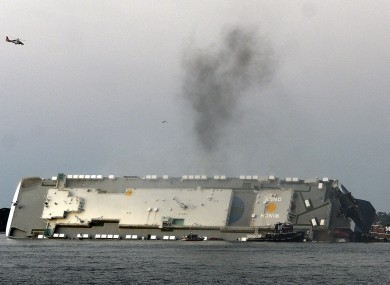 Smoke rising from the overturned vessel in the US.