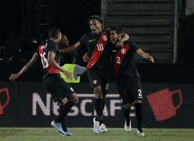 Heads up: Abram, right, leads Peru's celebrations.