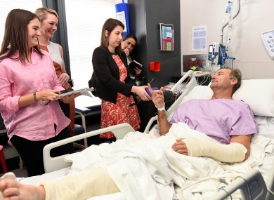 Neil Parker speaks to media from his hospital bed in Brisbane.