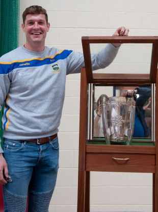 Séamus Callanan standing alongside the display cabinet he made for his Leaving Cert project.