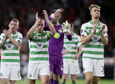 Celtic players greet supporters at the final whistle.