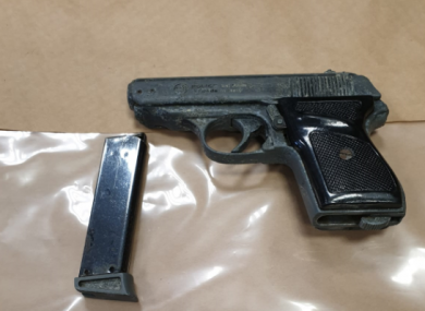 A gun seized during the search.