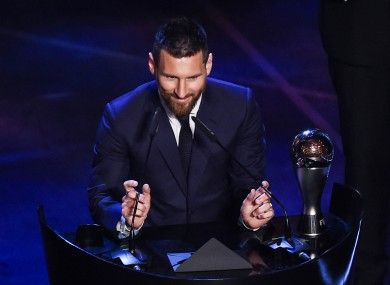 Lionel Messi collects his award.