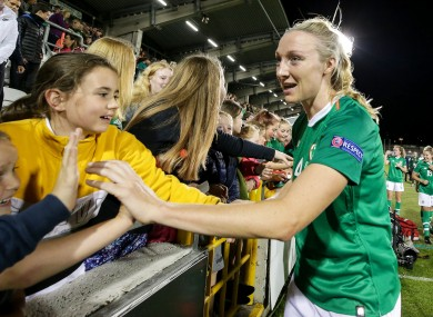 Louise Quinn celebrates with fans after the game.