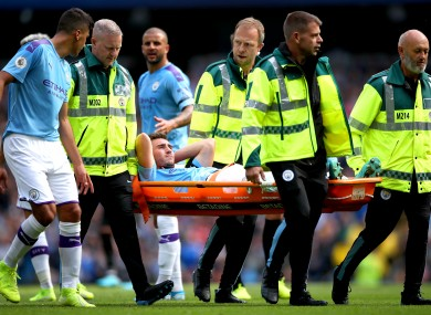 Laporte is stretchered off against Brighton last month.