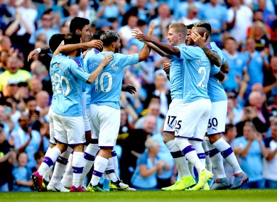 Manchester City players celebrate as David Silva scores their first goal.