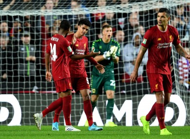 Liverpool's Ki-Jana Hoever (second left) celebrates scoring.