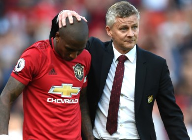 Job done: Ole Gunnar Solskjaer with Ashley Young.