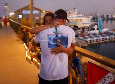 Mourners at a makeshift memorial at the Sea Landing in the Santa Barbara Harbour