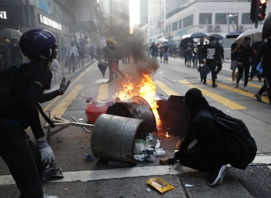 Anti-government protestors set fire to block traffic in Hong Kong