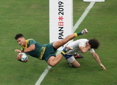 Australia's Jordan Petaia scores his side's second try during their pool match against Uruguay.