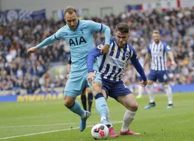 Christian Eriksen and Aaron Connolly battle for possession.