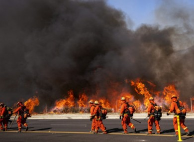 Inmate firefighters work to contain flames in California.