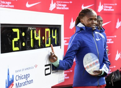 Brigid Kosgei of Kenya, poses with her time after winning in Chicago.