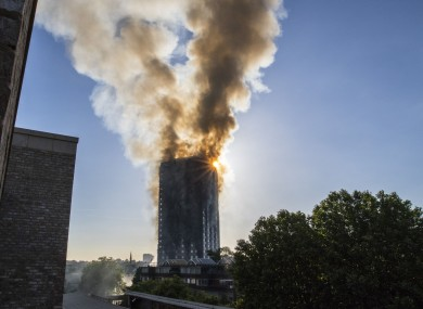 Smoke billows from a fire at Grenfell Tower in west London