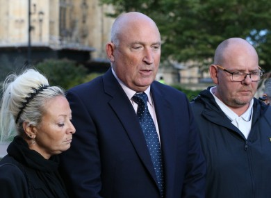 Harry Dunn's mother Charlotte Charles and father Tim Dunn either side of family spokesman Radd Seiger.