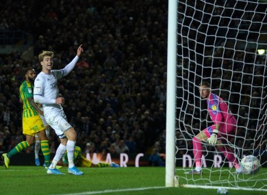 Leeds United's Patrick Bamford watches as Ezgjan Alioski (hidden) scores his side's first goal.