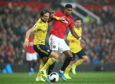 Arsenal's David Luiz (left) and Manchester United's Marcus Rashford battle for the ball.